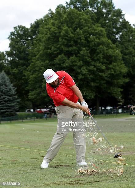 Andrew Johnston of England swings at a teed up hamburger during a portrait session after the third round of the World Golf Championships Bridgestone...