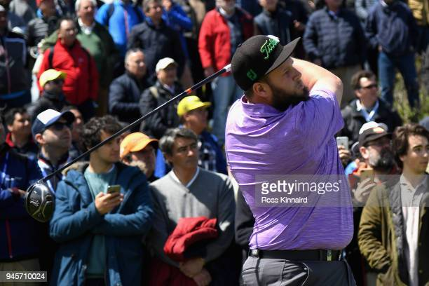 Andrew Johnston of England takes a shot of the 2nd tee during day two of the Open de Espana at Centro Nacional de Golf on April 13 2018 in Madrid...