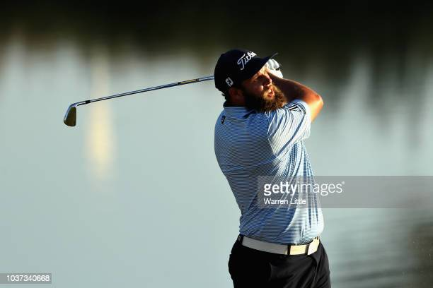 Andrew Johnston of England takes his second shot on hole eighteen during Day Two of the Portugal Masters at Dom Pedro Victoria Golf Course on...