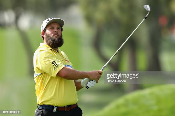Andrew Johnston of England takes his second shot on hole one during Day Four of the Omega Dubai Desert Classic at Emirates Golf Club on January 27...