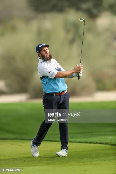 Andrew Johnston of England takes his second shot on the 16th hole during the first round of the Omega Dubai Desert Classic on the Majlis Course at...