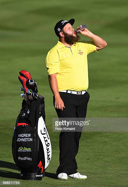 Andrew Johnston of England takes on refreshments whilst playing the 17th hole during the first round of the Omega European Masters at CranssurSierre...