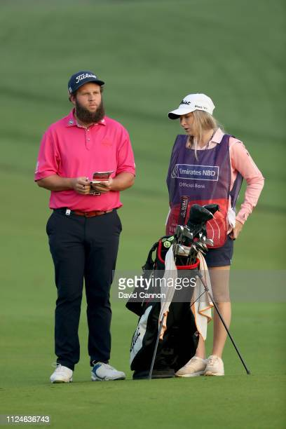 Andrew Johnston of England waits to play his second shot on the par 5 10th hole with his fiancee and caddy Jodie Valencia during the second round of...
