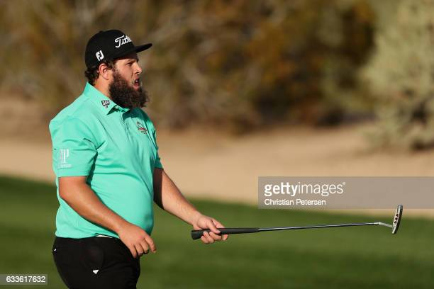 Andrew Johnston of England walks up to the second green during the first round of the Waste Management Phoenix Open at TPC Scottsdale on February 2...