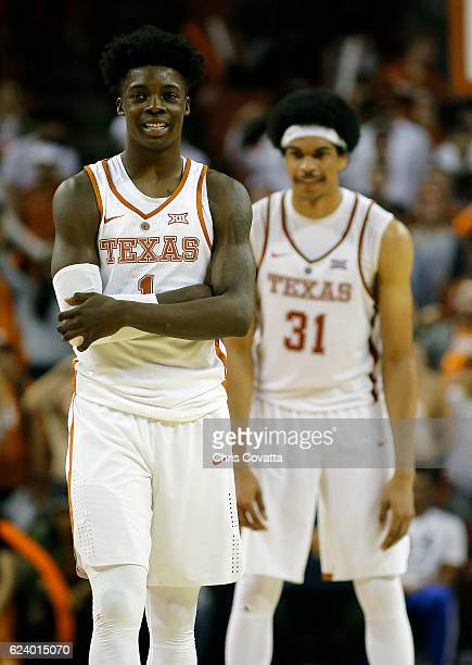 Andrew Jones and Jarrett Allen of the Texas Longhorns stand on the court during the game with the Incarnate Word Cardinals at the Frank Erwin Center...