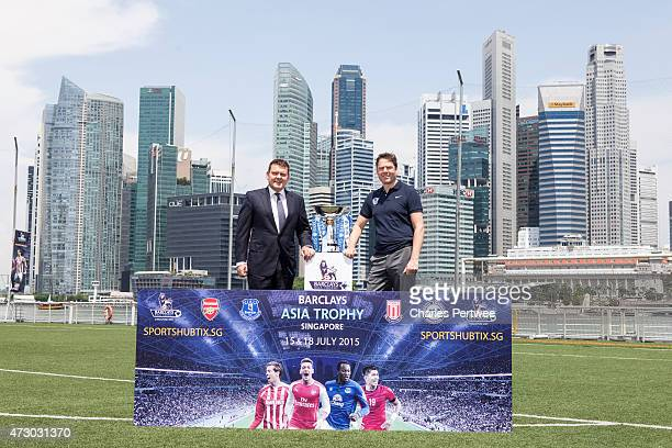 Andrew Jones Barclays Asia coCEO and Richard Masters director of sales and marketing of the Premiere League pose with the Barclays Asia Trophy during...