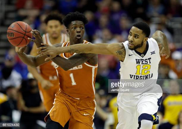 Andrew Jones of the Texas Longhorns controls the ball as Tarik Phillip of the West Virginia Mountaineers defends during the quarterfinal game of the...