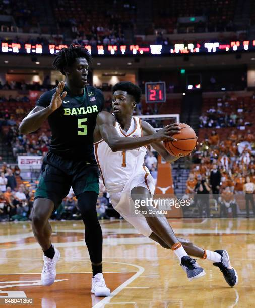 Andrew Jones of the Texas Longhorns drives around Johnathan Motley of the Baylor Bears at the Frank Erwin Center on March 4 2017 in Austin Texas