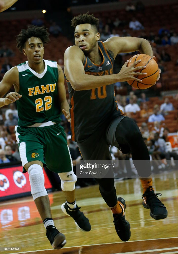 Andrew Jones #1 of the Texas Longhorns drives around Marcus Barham #22 of the Florida A&M Rattlers against Florida A&M Rattlers at the Frank Erwin Center on November 18, 2017 in Austin, Texas.