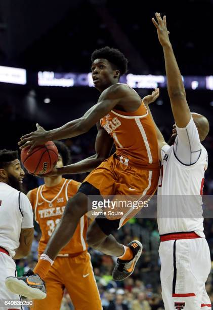 Andrew Jones of the Texas Longhorns drives toward the basket during the first round game of the Big 12 Basketball Tournament against the Texas Tech...