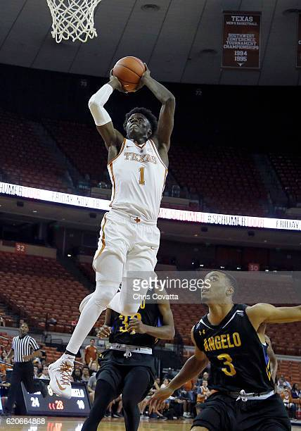 Andrew Jones of the Texas Longhorns dunks the ball over Lorenzo Dillard of the Angelo State Rams during an exhibition game at the Frank Erwin Center...