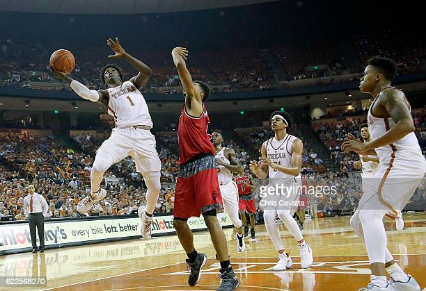 Andrew Jones of the Texas Longhorns leaps to the basket against Devin Wyatt of the Incarnate Word Cardinals at the Frank Erwin Center on November 11...