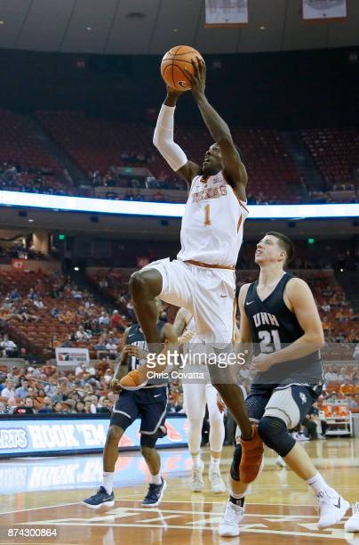 Andrew Jones of the Texas Longhorns leaps to the basket against Tanner Leissner of the New Hampshire Wildcats at the Frank Erwin Center on November...