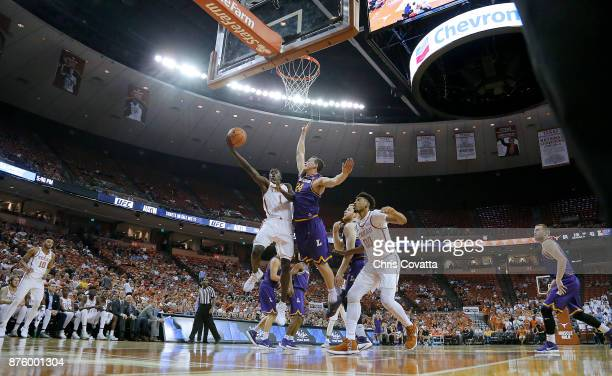 Andrew Jones of the Texas Longhorns leaps to the basket against Garrison Mathews of the Lipscomb Bisons at the Frank Erwin Center on November 18 2017...