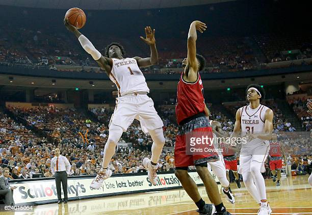 Andrew Jones of the Texas Longhorns leaps to the basket against the Incarnate Word Cardinals at the Frank Erwin Center on November 11 2016 in Austin...