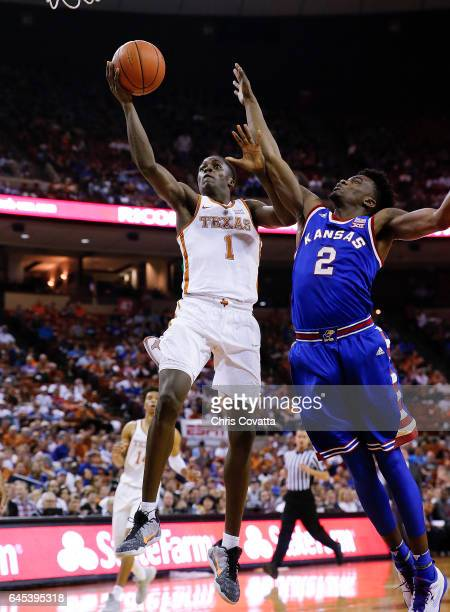 Andrew Jones of the Texas Longhorns leaps to the basket against Lagerald Vick of the Kansas Jayhawks at the Frank Erwin Center on February 25 2017 in...