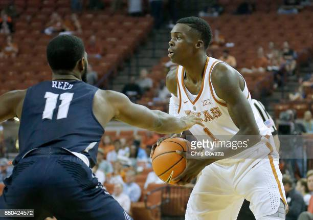 Andrew Jones of the Texas Longhorns looks to pass the ball as Jordan Reed of the New Hampshire Wildcats defends him at the Frank Erwin Center on...