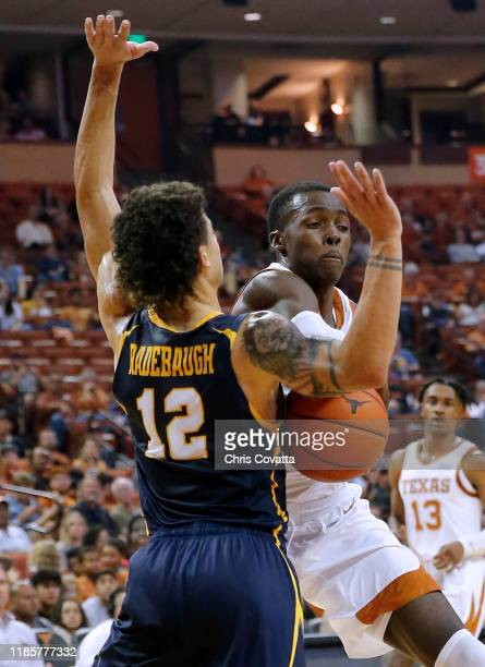 Andrew Jones of the Texas Longhorns passes the ball against Jonah Radebaugh of the Northern Colorado Bears at The Frank Erwin Center on November 05...