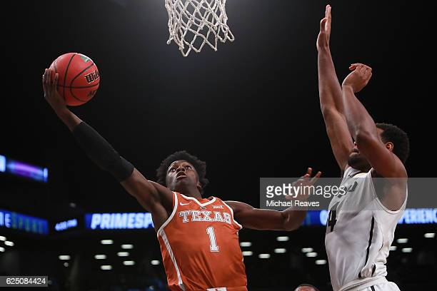 Andrew Jones of the Texas Longhorns puts up a layup over Tory Miller of the Colorado Buffaloes in the first half during the consolation game of the...