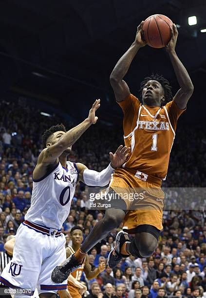 Andrew Jones of the Texas Longhorns shoots against Frank Mason III of the Kansas Jayhawks in the second half at Allen Field House on January 21 2017...