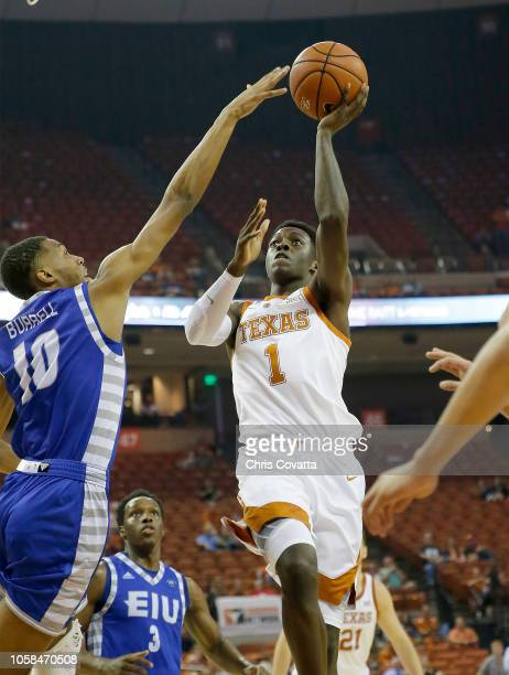 Andrew Jones of the Texas Longhorns shoots over Cam Burrell of the Eastern Illinois Panthers at the Frank Erwin Center on November 6 2018 in Austin...