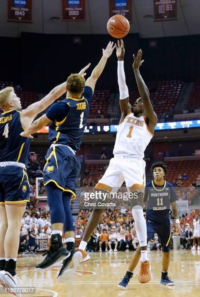 Andrew Jones of the Texas Longhorns shoots over Cole Bergan and Trent Harris of the Northern Colorado Bears at The Frank Erwin Center on November 05...