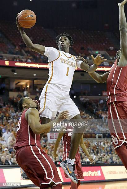 Andrew Jones of the Texas Longhorns shoots over Jordan Woodard of the Oklahoma Sooners at the Frank Erwin Center on January 23 2017 in Austin Texas