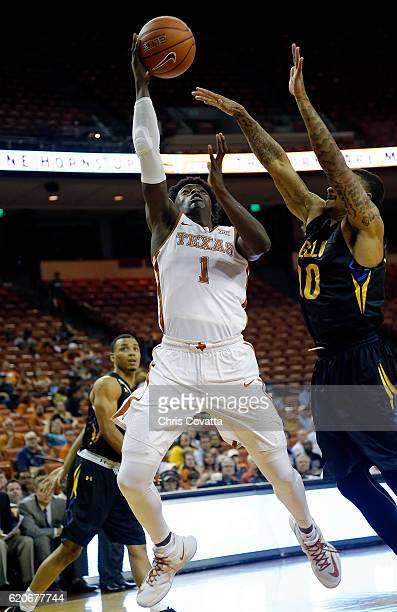 Andrew Jones of the Texas Longhorns shoots the ball against Andre Nikita of the Angelo State Rams of the Angelo State Ramsduring an exhibition game...