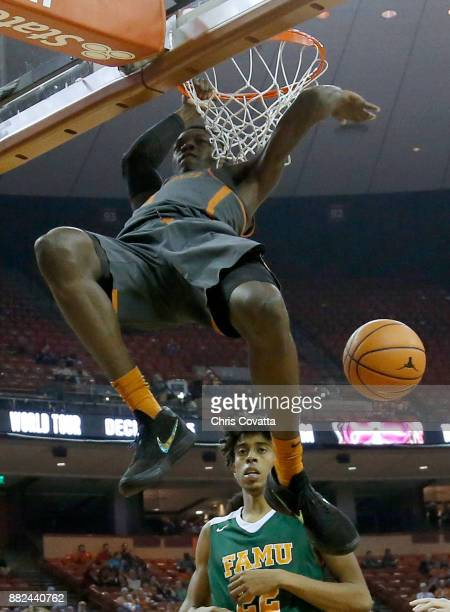Andrew Jones of the Texas Longhorns slam dunks against Florida AM Rattlers at the Frank Erwin Center on November 18 2017 in Austin Texas