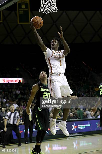 Andrew Jones of the Texas Longhorns takes a shot against Manu Lecomte of the Baylor Bears in the first half at Ferrell Center on January 17 2017 in...