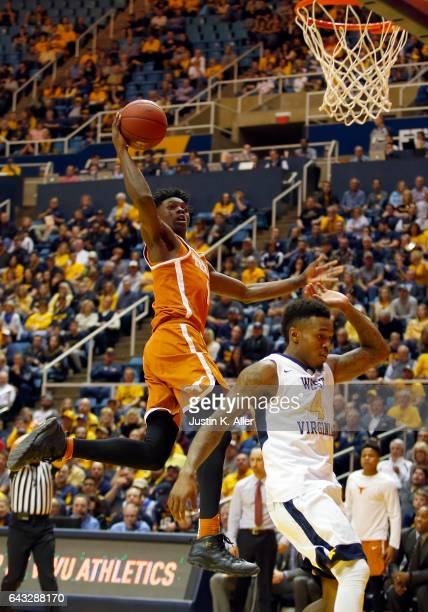 Andrew Jones of the Texas Longhorns takes the ball to the hoop against Daxter Miles Jr #4 of the West Virginia Mountaineers at the WVU Coliseum on...