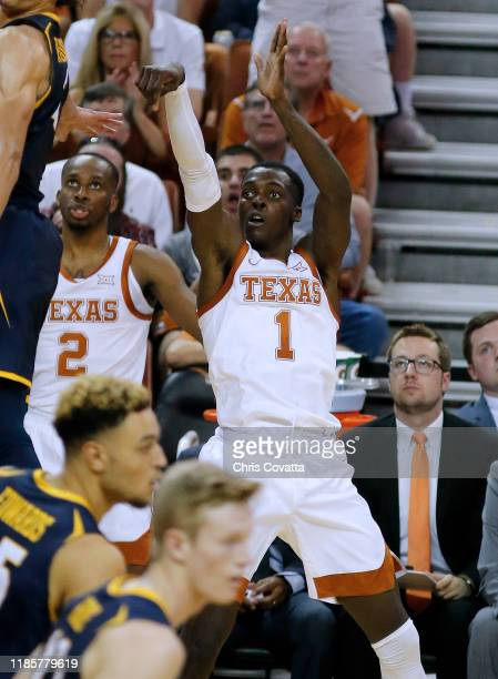 Andrew Jones of the Texas Longhorns watches his three point shot go in the basket during the game with the Northern Colorado Bears Jones lead his...