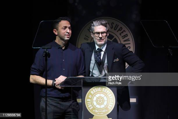 Andrew Kahn and Matt Biffa speak onstage during the 9th Annual Guild of Music Supervisors Awards on February 13 2019 at The Theatre at Ace Hotel in...