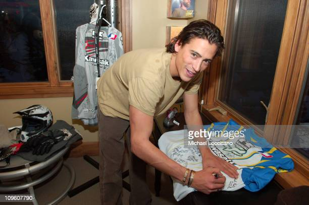 Andrew Keegan signs charity Fox jersey in SPY goggles Freestyle watch and Fox Racing suite