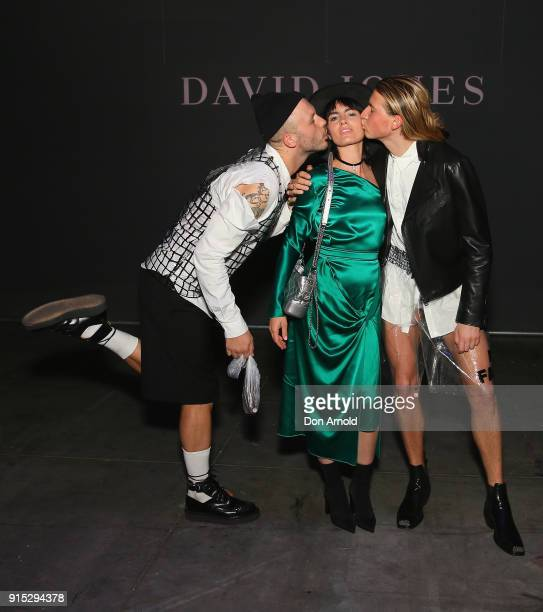 Andrew Kelly and Christian Wilkins kiss Isabella Manfredi just after the David Jones Autumn Winter 2018 Collections Launch at Australian Technology...