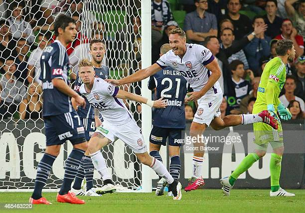 Andrew Keogh of the Glory celebrates after scoring the first goal during the round 20 ALeague match between Melbourne Victory and Perth Glory at AAMI...
