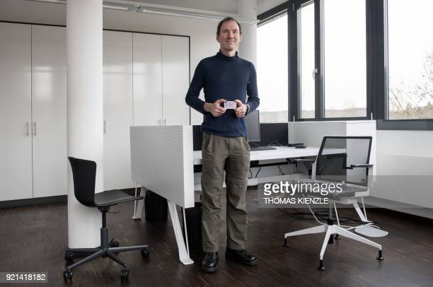 Andrew Ketley a British business intelligence consultant who moved to Munich poses with his British ID card in an office in Heilbronn southwestern...