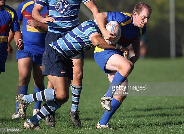 Andrew Kitchener of the Hornets is tackled during the Fox Memorial Championship match between the Otahuhu Leopards and Howick Hornets at Paparoa Park...