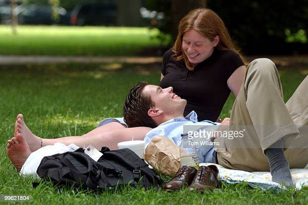 Andrew Klein, intern for Sen. Chuck Hagel, R-NE, and Emily Newman of Michigan, relax in the park near Russell Building, Tuesday afternoon.