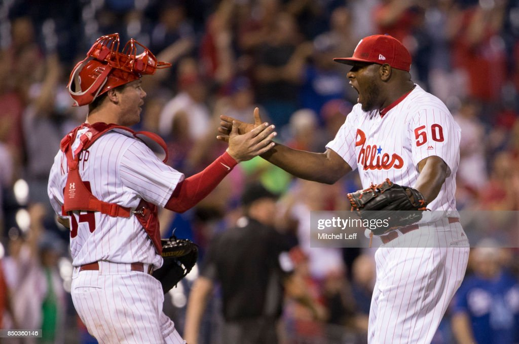 Andrew Knapp #34 and Hector Neris #50 of the Philadelphia Phillies celebrate at the end of the game against the Los Angeles Dodgers at Citizens Bank Park on September 20, 2017 in Philadelphia, Pennsylvania. The Phillies defeated the Dodgers 7-5.