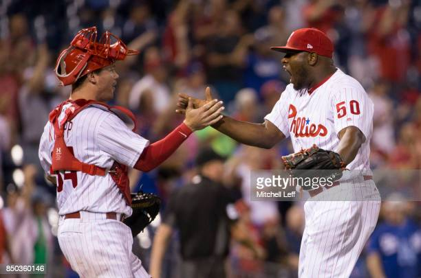 Andrew Knapp and Hector Neris of the Philadelphia Phillies celebrate at the end of the game against the Los Angeles Dodgers at Citizens Bank Park on...