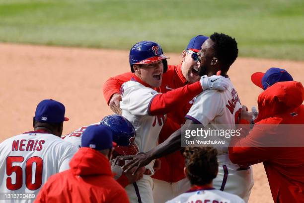 Andrew Knapp of the Philadelphia Phillies celebrates with teammates following his walk-off single against the San Francisco Giants at Citizens Bank...