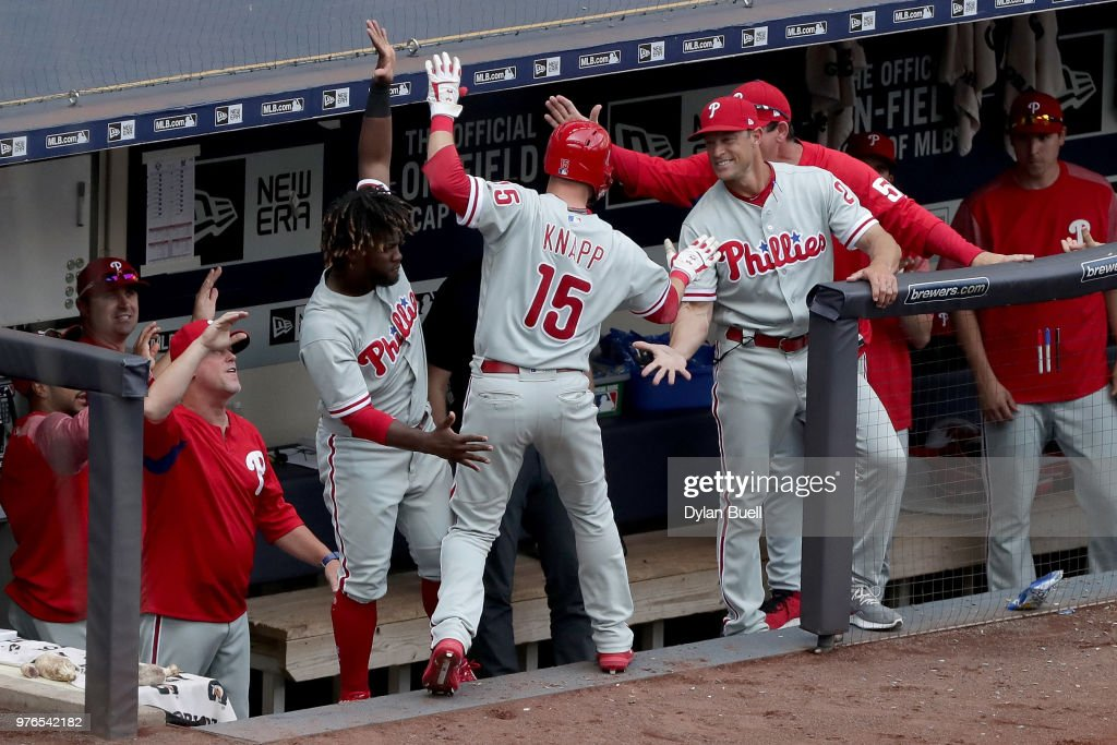 Andrew Knapp #15 of the Philadelphia Phillies celebrates with teammates after hitting a home run in the fifth inning against the Milwaukee Brewers at Miller Park on June 16, 2018 in Milwaukee, Wisconsin.