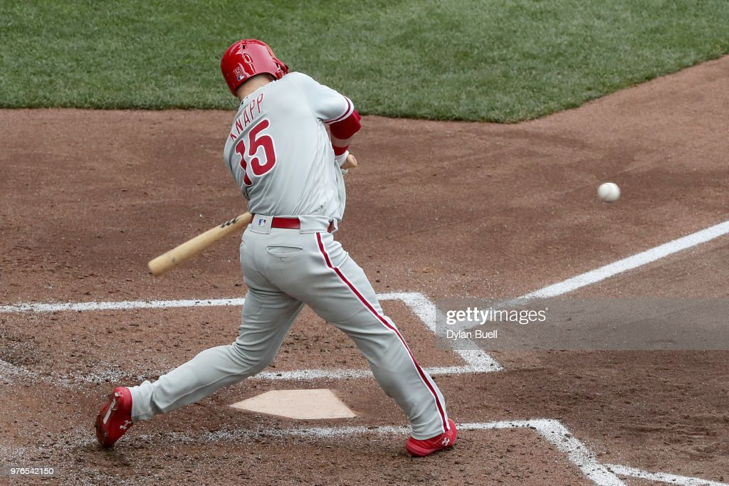 Andrew Knapp #15 of the Philadelphia Phillies hits a home run in the fifth inning against the Milwaukee Brewers at Miller Park on June 16, 2018 in Milwaukee, Wisconsin.