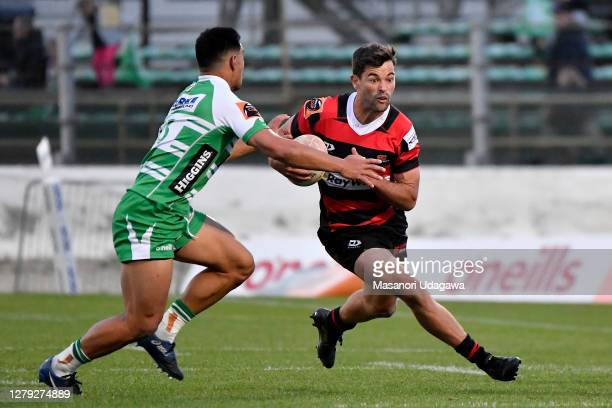 Andrew Knewstubb of Canterbury is tackled during the round 5 Mitre 10 Cup match between Manawatu and Canterbury at Central Energy Trust Arena on...