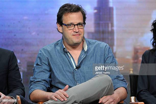 Andrew Kreisberg speaks onstage during the CW portion of the 2016 Television Critics Association Summer Tour at The Beverly Hilton Hotel on August 11...