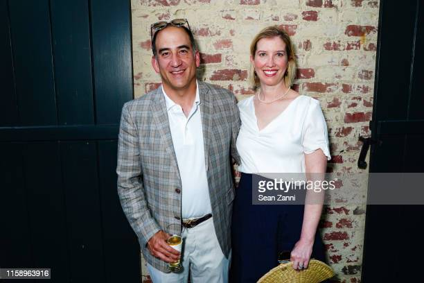 Andrew Kurita and Alexis Barr attend A Country House Gathering To Benefit Preservation Long Island on June 28 2019 in Locust Valley New York