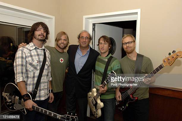 """Andrew Lack, Chairman and CEO of Sony Music Entertainment with the Foo Fighters backstage during the """"Shelter from the Storm: A Concert for the Gulf..."""