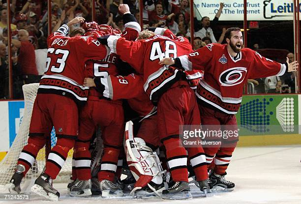 Andrew Ladd and the Carolina Hurricanes celebrates after defeating the Edmonton Oilers in game seven of the 2006 NHL Stanley Cup Finals on June 19...