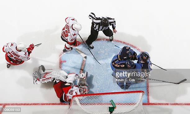 Andrew Ladd of the Atlanta Thrashers celebrates scoring on goaltender Cam Ward of the Carolina Hurricanes with Bryan Little and Niclas Bergfors at...